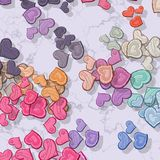 Pastel colored hearts randomly scattered on patterned background Royalty Free Stock Photography