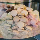 Pastel colored macarones on a plate Stock Images