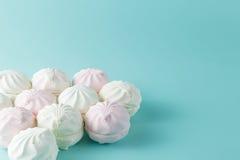 Pastel colored marshmallow  on aquamarine bright background Royalty Free Stock Photography