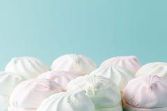 Pastel colored marshmallow  on aquamarine bright background Royalty Free Stock Images