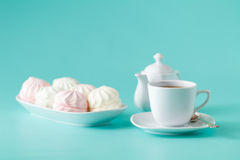Pastel colored marshmallow and cup of tea Royalty Free Stock Images