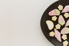 Pastel colored marshmallows on a plate Royalty Free Stock Images
