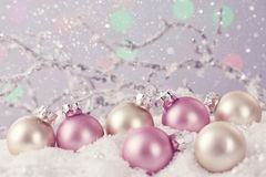 Pastel colored ornaments. On snow Stock Photo