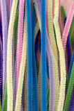 Pastel colored pipe cleaners. This is a photograph of Pastel colored pipe cleaners Stock Photo