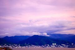 Pastel colored sky as storm brews over Puerto Vallarta. And the weather comes in Stock Photo