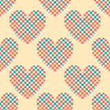 Pastel colored tartan checkered hearts on beige seamless pattern, vector royalty free illustration