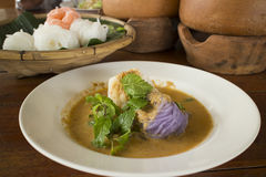 Pastel colored Thai rice noodle with curry fish soup Stock Photo
