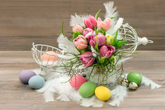 Pastel colored tulip flowers and easter eggs Stock Photo