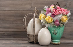 Pastel colored tulip flowers with vintage easter eggs decoration Royalty Free Stock Photos