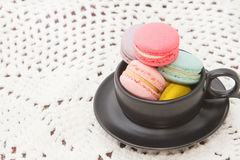France  macaroon in coffee cup Royalty Free Stock Photos