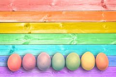 Pastel colorful rainbow painted eggs wood planks background. Pastel colorful rainbow paintedeggs, wood planks background royalty free stock photo