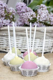 Pastel colors cake pops on hessian Stock Photography