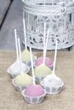Pastel colors cake pops on hessian Stock Image