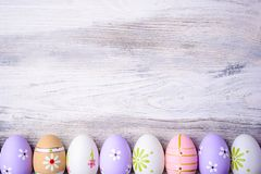 Pastel colors Easter eggs on a grey wooden background. Royalty Free Stock Images