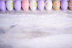Pastel colors Easter eggs on a grey wooden background. Stock Photos