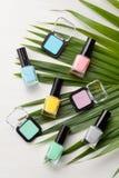 Pastel colors nail polish. Beauty blogger concept. Nail polish of various pastel colors and colorful candies. Mockup or Beauty blogger concept stock image