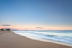 Pastel colors at sunset on a sicilian beach royalty free stock photography