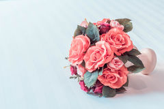 Pastel Coloured Artificial Pink Rose Wedding Bridal Bouquet. Stock Photo
