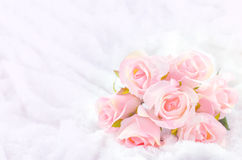 Pastel Coloured Artificial Pink Rose on white fur background. Pastel Coloured Artificial Pink Rose Wedding Bridal Bouquet on white fur background with soft Stock Images