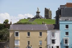 Colourful houses and Prince Albert monument in Tenby, South Wales. Pastel coloured houses in front of the Prince Albert memorial and castle in Tenby, coastal stock image