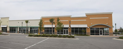 Pastel commercial strip mall pano. Pastel colored commercial shopping mall panoramic Stock Photos