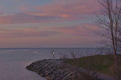Pastel contrasts in the predawn light over Lake Ontario Stock Images