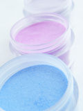 Pastel cosmetic makeup. Pastel colored cosmetic makeup in jars Stock Photos