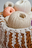 Pastel cotton skeins in a basket Stock Photos