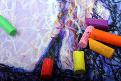 Pastel crayon. Coloured pastel crayon on a begun drawing Royalty Free Stock Image