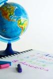 Pastel crayons and globe. Royalty Free Stock Photo