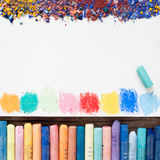 Pastel crayons and  paper sheet of sketchbook Royalty Free Stock Photography