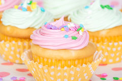 Pastel cupcakes with sprinkles Stock Photo