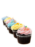 Pastel cupcakes on a white background Royalty Free Stock Images