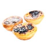 Pastel de Belem - Portuguese egg tarts pastry isolated on white. Background. Heap of Pastel de nata macro Stock Photography