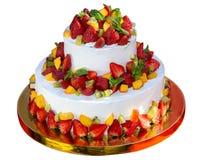 Pastel de bodas con las bayas de la fresa, del kiwi, del melocotón y de la menta Fotos de archivo libres de regalías
