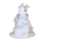 Pastel de bodas moderno aislado en blanco Imágenes de archivo libres de regalías