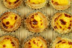 Pastel de nata. Traditional Lisbon egg tarts - pastries pasteis de nata in tin moulds Stock Photos
