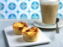 Pastel de nata and coffee latte royalty free stock images