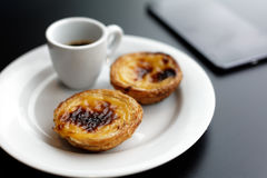 Pastel de nata and coffee stock photography