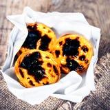 Pastel de Nata - creamy egg tart with  sweet curstard, black cru. St and sugar powder on wooden background. Pasteis de Belem pastry Royalty Free Stock Images