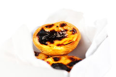 Pastel de Nata - creamy egg tart with  sweet curstard in a box i Royalty Free Stock Images