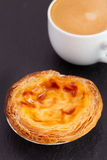 Pastel de nata with cup Royalty Free Stock Image