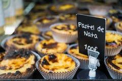 Pastel de Nata displayed on a tray. stock photo