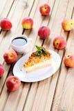 Pastel de queso de los melocotones fotografía de archivo