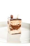 Pastel de queso del chocolate aislado en el fondo blanco Fotos de archivo