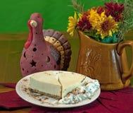Pastel de queso en la tabla de la acción de gracias Imagen de archivo libre de regalías