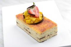 Pastel de queso rectangular imagen de archivo