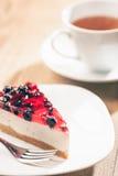 Pastel de queso y té Fotos de archivo libres de regalías