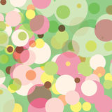 Pastel Dots. In random sizes against a pale green background Royalty Free Stock Image