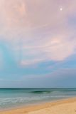 Pastel dusk time on desert beach with moon Stock Image